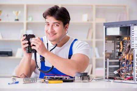 Computer repairman repairing desktop computer Stock Photo