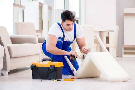 Furniture repairman working in store