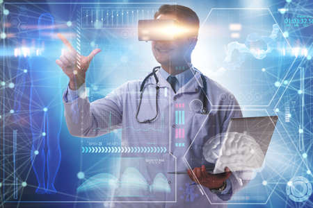 Telemedicine concept with doctor wearing VR glasses 스톡 콘텐츠
