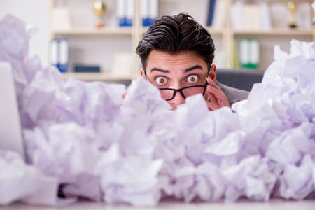 Businessman in paper recycling concept in office Stock Photo