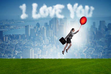 Woman flying balloons in romantic concept Imagens
