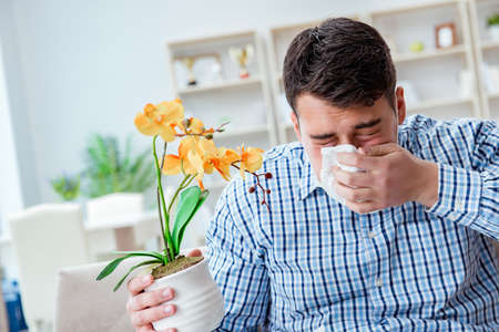 Man suffering from allergy - medical concept