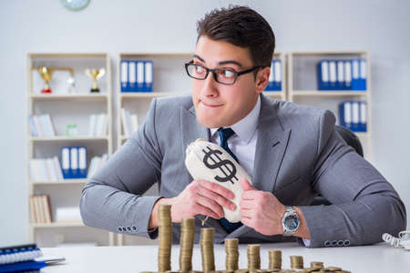 Businessman with golden coins in business growth concept 版權商用圖片