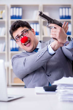 Clown businessman working in the office frustrated committing su