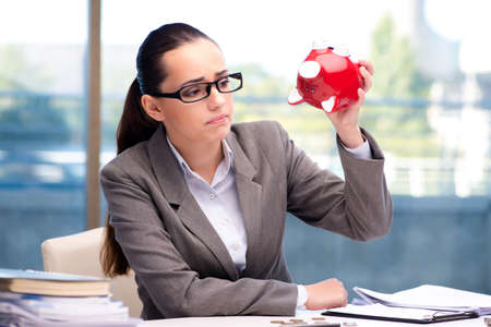 Bankrupt broke businesswoman with piggy bank Banco de Imagens - 82310639