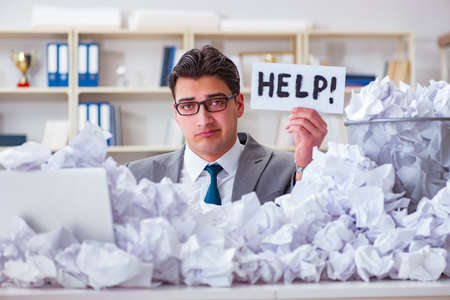Businessman in paper recycling concept in office Reklamní fotografie