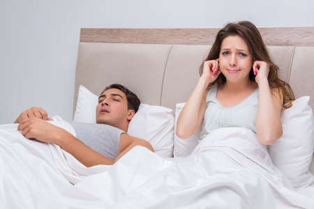 Woman having trouble with husband snoring Stock Photo