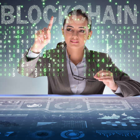 Businesswoman in blockchain cryptocurrency concept Zdjęcie Seryjne - 82742583