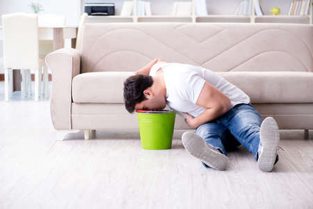 Man suffering from sick stomach and vomiting