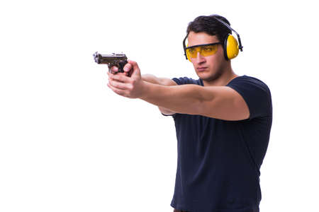 Man doing sport shooting from gun isolated on white Фото со стока