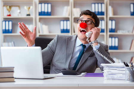 Clown businessman having fun in the office Stock Photo