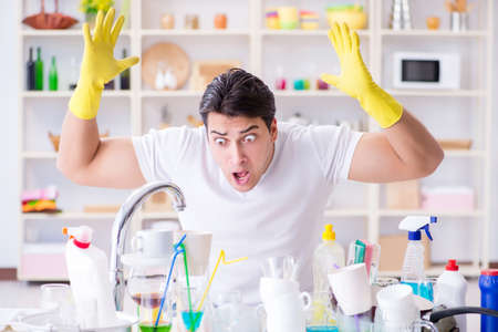 Man frustrated at having to wash dishes