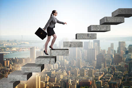 Businesswoman climbing career ladder in business concept Фото со стока - 84014820