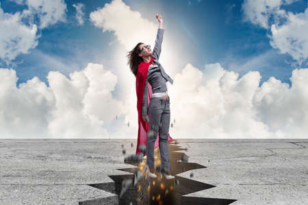 Superhero businesswoman escaping from difficult situation Stockfoto
