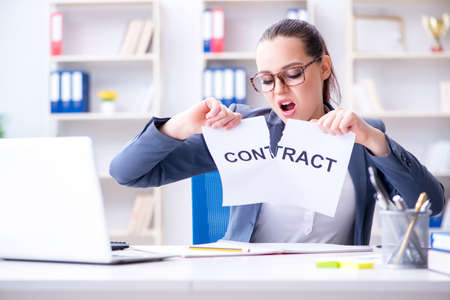 Businesswoman tearing apart her contract Stock Photo