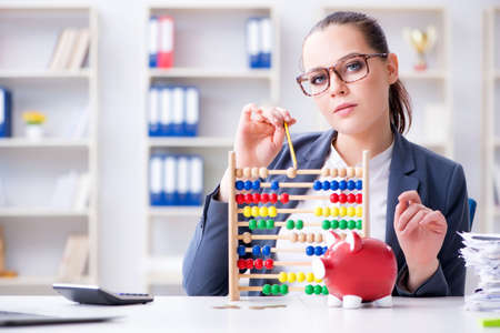 Businesswoman in pension savings concept Stock Photo