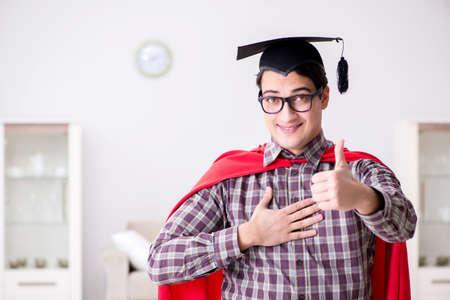 Super hero student wearing mortarboard in a red cloak Фото со стока