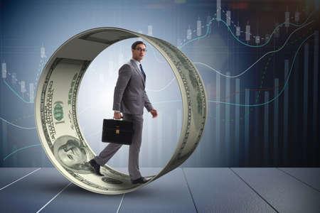 Zakenman in hamsterwiel achtervolgen dollars Stockfoto