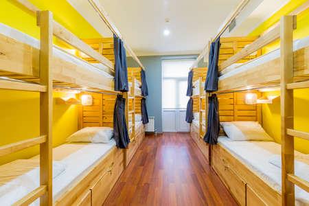 Hostel dormitory beds arranged in room Banco de Imagens - 84372549