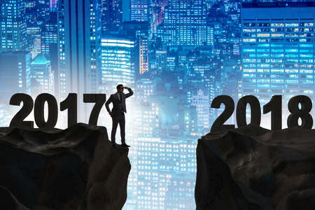 Businessman looking forward to 2018 from 2017
