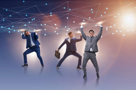 Businessmen supporting network mesh in concept