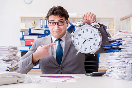 Businessman missing deadlines due to excessive work Stock Photo