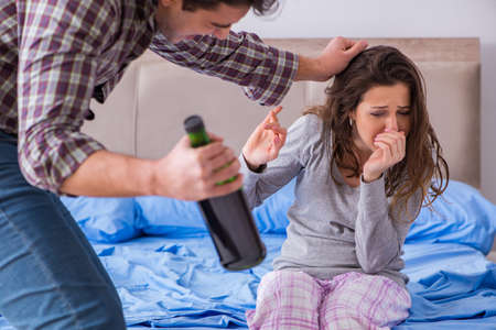 Domestic violence concept in a family argument with drunk alcoho Stock Photo