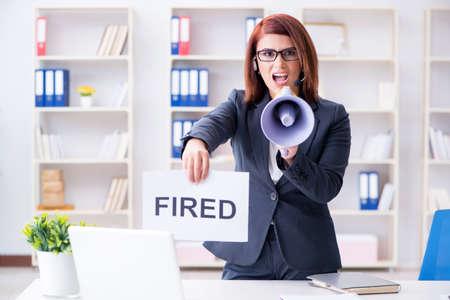 Businesswoman firing people in office Stock Photo
