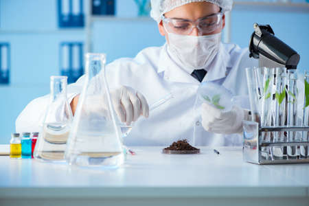 Male scientist researcher doing experiment in a laboratory Stock Photo