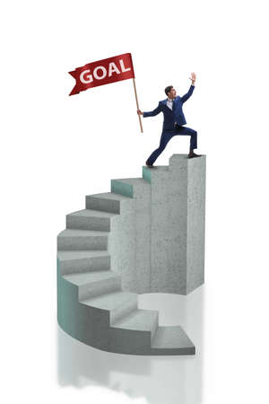 Businessman with goal banner isolated on white