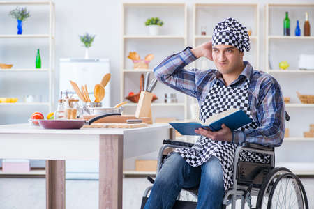Young man cook with book of food recipes stock photo picture and young man cook with book of food recipes photo forumfinder Image collections