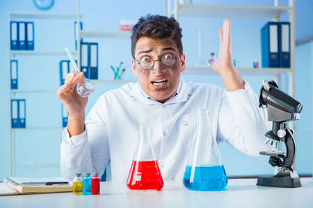 Funny mad chemist working in a laboratory Stock Photo