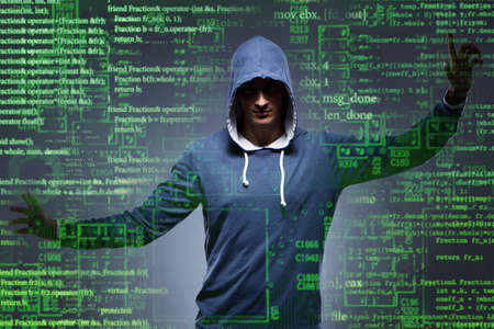 Young hacker in cyber security concept Фото со стока