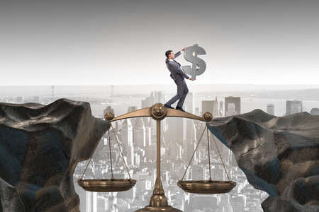 Businessman holding dollar sign in justice concept