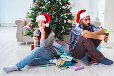 Young pair in conflict situation during christmas night