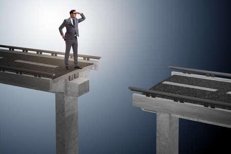 Businessman ready to overcome the broken bridge Stock Photo