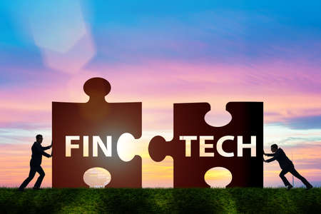 Fintech financial technology concept with puzzle pieces