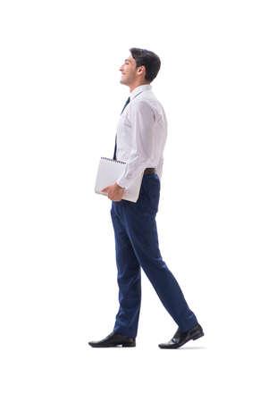 Gehende stehende Seitenansicht des Geschäftsmannes lokalisiert auf weißem backgro
