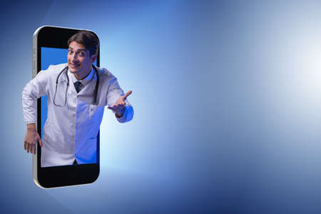 Telemedicine concept with doctor and smartphone Stock Photo