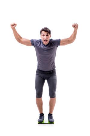 Sportman op de witte achtergrond wordt geïsoleerd die Stockfoto