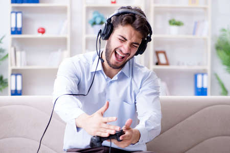 Student gamer playing games at home