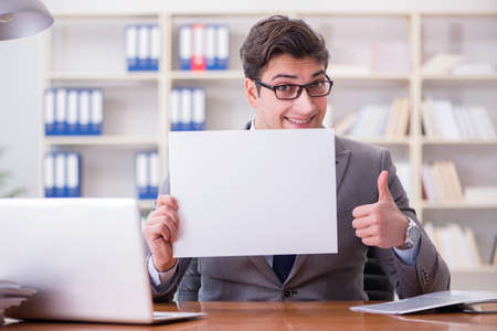Businessman In Office Holding A Blank Message Board Stock Photo   88108148