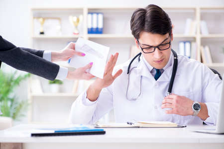 Young doctor in medical insurance fraud concept