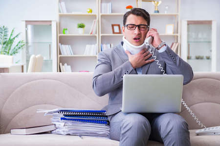 Man in neck brace cervical collar working from home teleworking