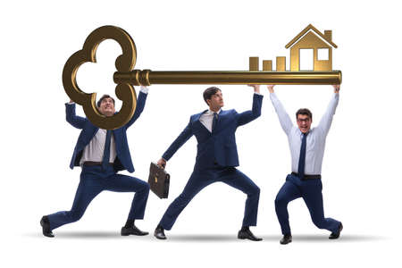 Businessmen holding giant key in real estate concept Stock Photo