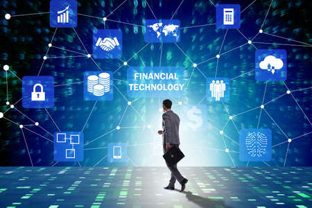 Businesswoman walking towards financial technology fintech Foto de archivo