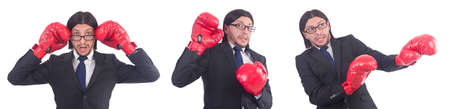 Businessman with boxing gloves on white background