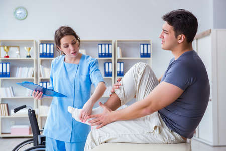 Doctor and patient during check-up for injury in hospital