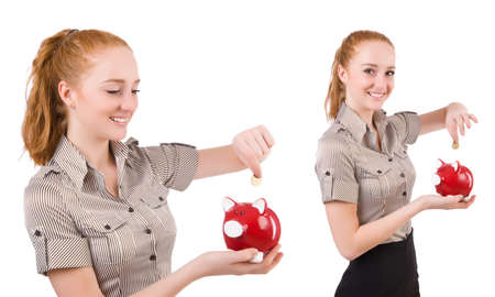 Redhead with piggybank isolated on the white Stock Photo