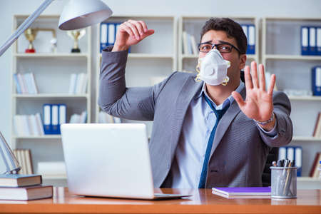 Businessman sweating excessively smelling bad in office at workp Stock Photo